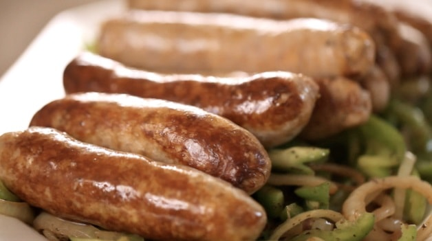 Sausages and onions on platter