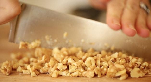 chopping walnuts on a cutting board