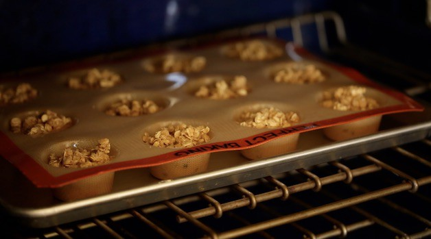 Muffins in a silpat baking mold in the oven