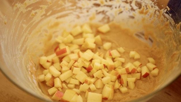 Diced apple in apple cinnamon muffin batter