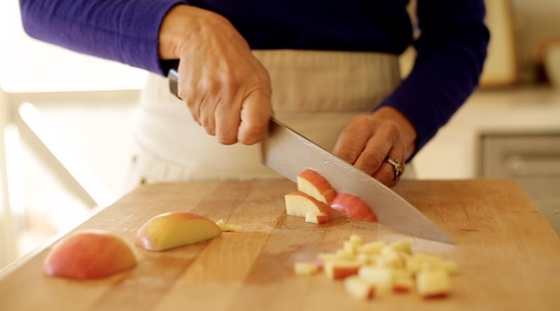 Dicing apples on cutting board