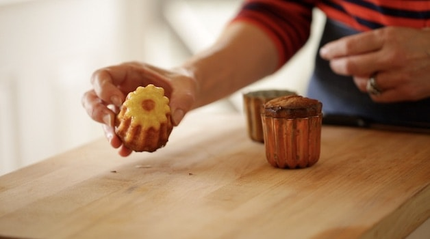 A canele not very caramelized from a copper mold