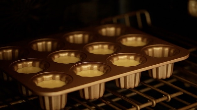 Canele mold pan in oven ready for baking