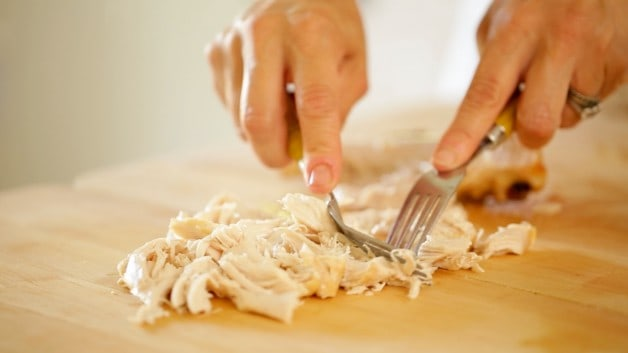 Shredding chicken for Raw chicken on wire rack for Enchiladas Suizas