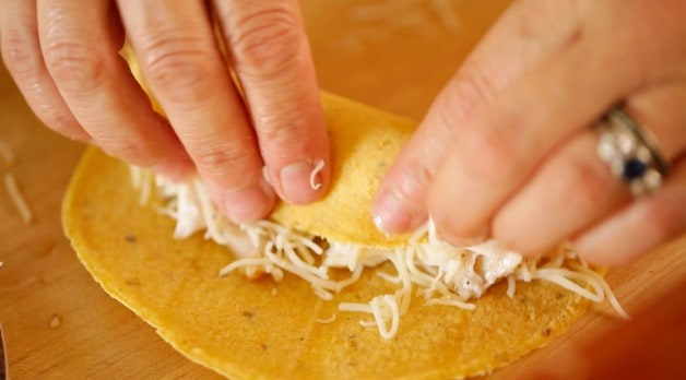 Rolling Enchilada with chicken and cheese in a corn tortilla