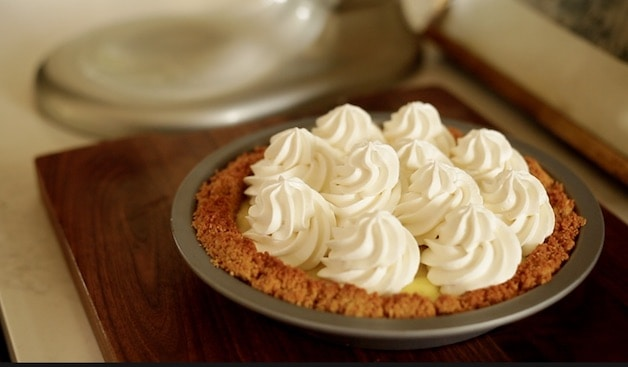 A cococut cream pie ready to be set in the refrigerator