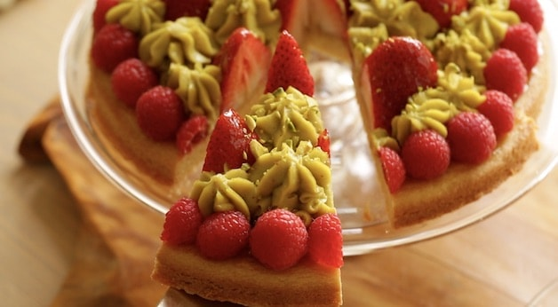 Serving a slice of strawberry pistachio tart