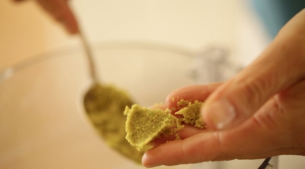 holding a pat of homemade pistachio paste