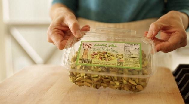 Fresh, raw pistachios in a plastic box