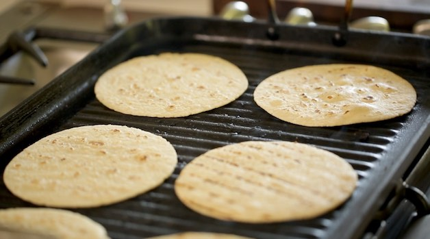 Grilling Corn Tortillas on an indoor grill pan for tacos