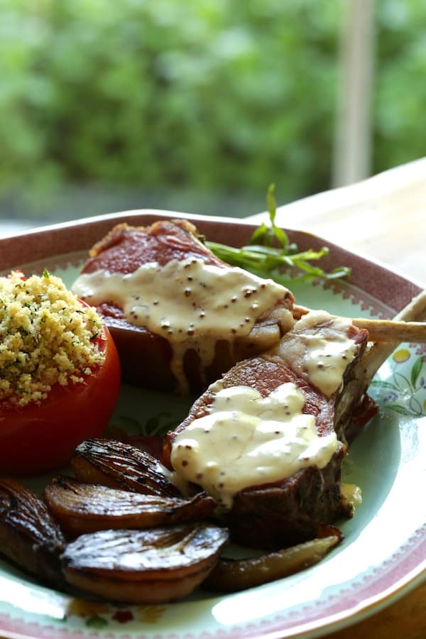Slow Roasted Lamb Chops with Mustard sauce, carmelized shallots and roasted tomato