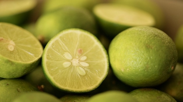 key limes in a bowl with a few sliced open