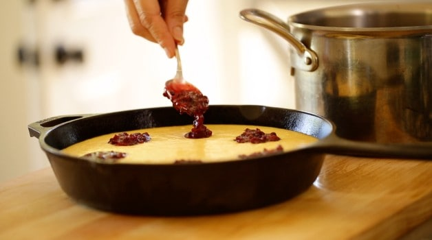Blackberry reduction spooned into cornbread batter