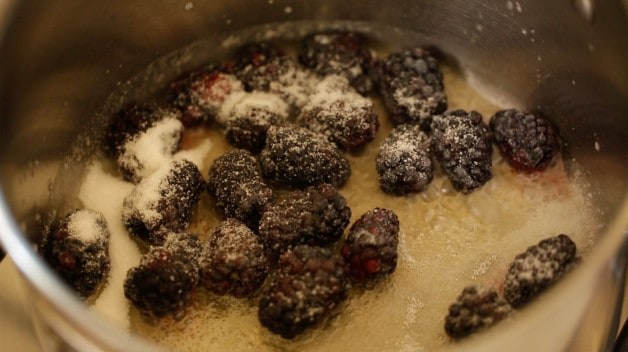 Blackberries covered in sugar in pot