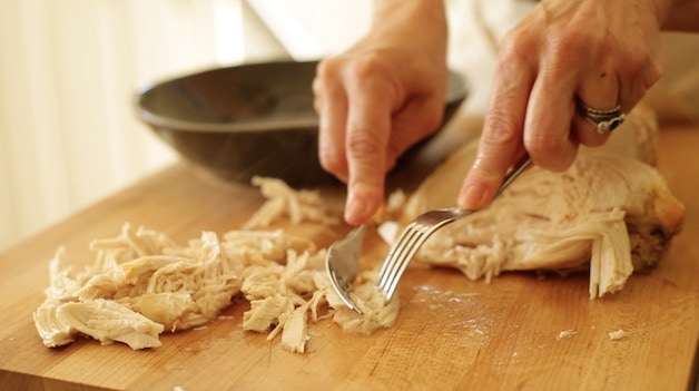 Shredding Roasted Chicken with a fork