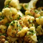 Vertical Image of Roasted Cauliflower and fresh parsley