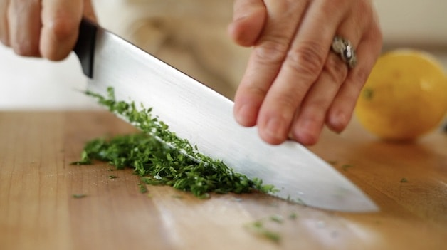 Chopping Fresh Parsley on a cutting board