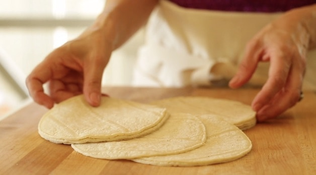 white corn tortillas on a cutting board