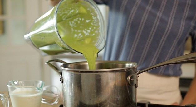 Adding pureed peas from a blender to a sauce pot