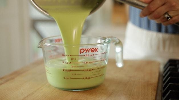 Pouring panna cotta mixture into a pyrex pitcher
