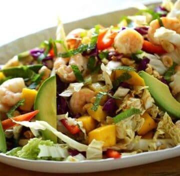 A platter of shrimp, avocado and mango salad