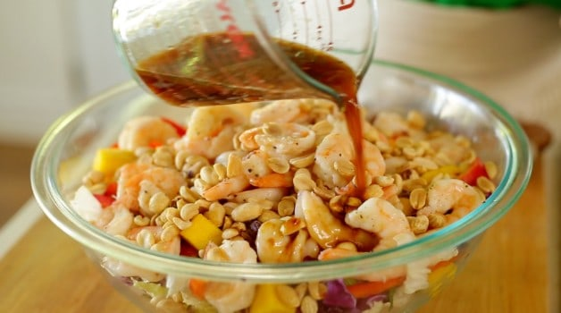 Dressing poured over shrimp salad