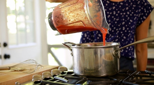 Strawberry puree poured into pot