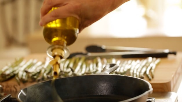 Oil drizzled in pan for Charred Asparagus Salad Recipe