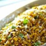 Charred Mexican Corn Salad Recipe in white serving bowl closeup