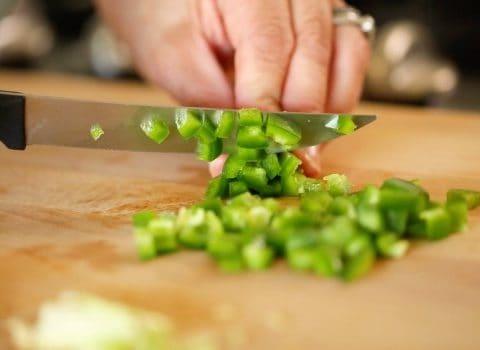 Chopped green onion on cutting board