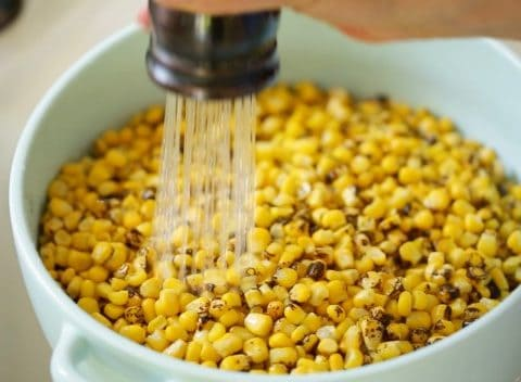 Rinsing corn for Charred Mexican Corn Salad Recipe