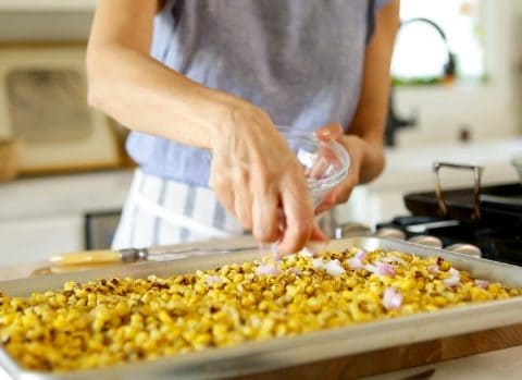 Corn on baking sheet for Charred Mexican Corn Salad Recipe