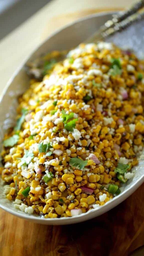 A shallow platter filled with Mexican Corn Salad