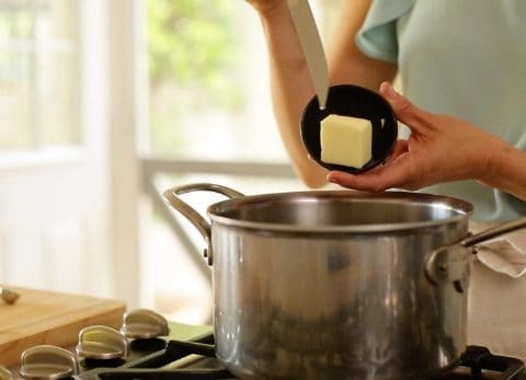 Butter put into pot with boiling water