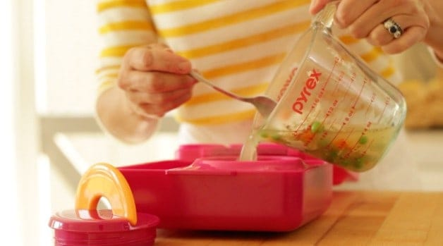 pouring chicken soup into Omie Lunchbox thermos