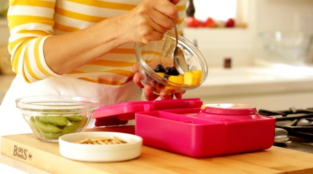Adding fruit to Omie Lunchbox