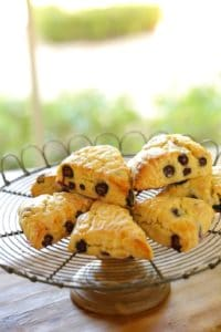 Blueberry scones with lemon glaze on a wire cake stand