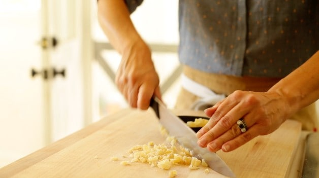 chopping candied ginger on a cutting board