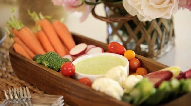 Veggies and green goddess dressing in wooden bowl