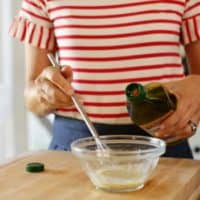 Adding olive oil to bowl to mix dressing for No-Mayo Potato Salad Recipe