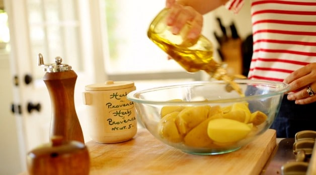 Potatoes in bowl with olive oil for No-Mayo Potato Salad Recipe