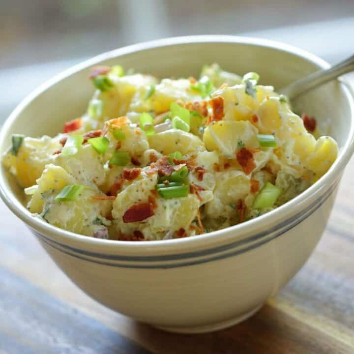 Traditional Potato Salad in a beige bowl with stripe