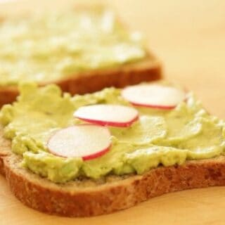 Avocado mixture on bread with sliced radish