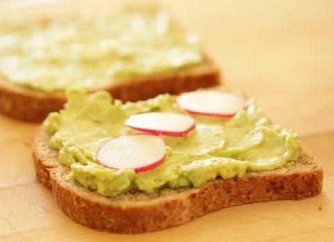 Avocado mixture on bread with sliced radish