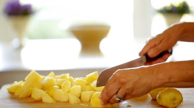 Golden Yukon Potatoes chopped on cutting board