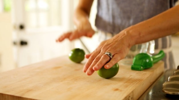Rolling limes on a cutting board