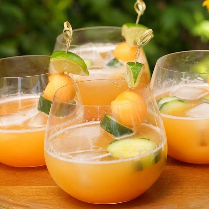 Agua Frescas in tumbler glasses with cucumber and melon garnishes