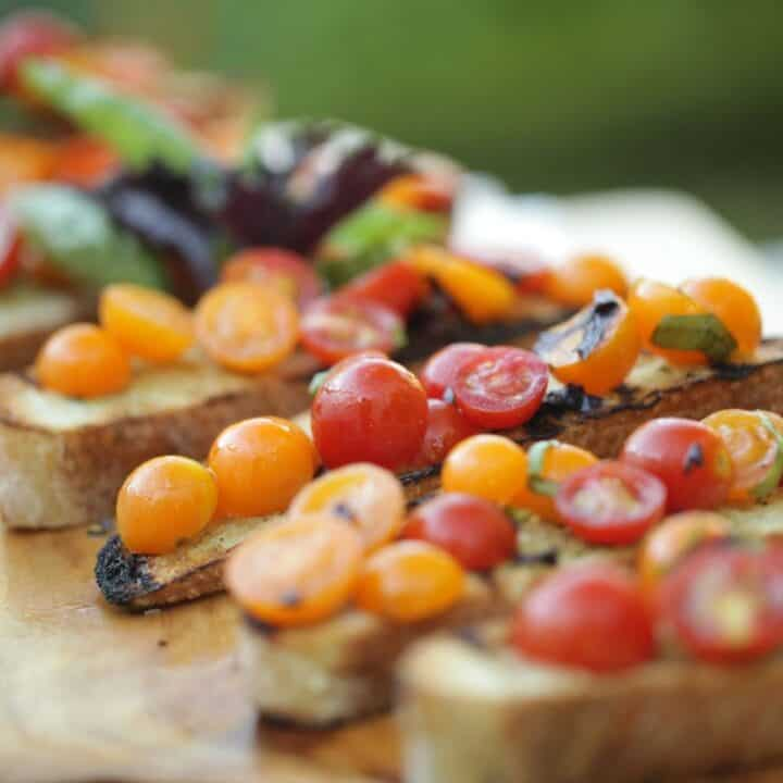 Cherry Tomatoes are grilled bread with 2 types of basil