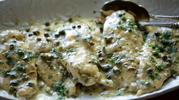 A platter of chicken piccata
