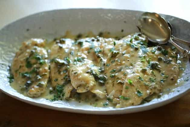 Platter of Chicken Piccata with lemon caper sauce